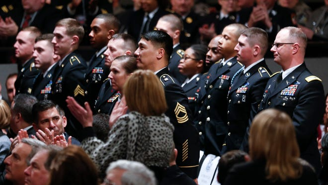 Soldiers from Fort Drum are recognized by Gov. Andrew Cuomo during his State of the State address and executive budget proposal Wednesday at Empire State Plaza Convention Center in Albany.