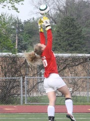 Churchill sophomore keeper Katherine Ristola elevates for a save Wednesday against Franklin.