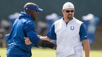 Robert Mathis (left), Pass Rush Consultant, chats with Brad White, Outside Linebackers Coach, during Colts practice, in advance of Sunday's game against Cleveland, Thursday, Sept. 21, 2017.