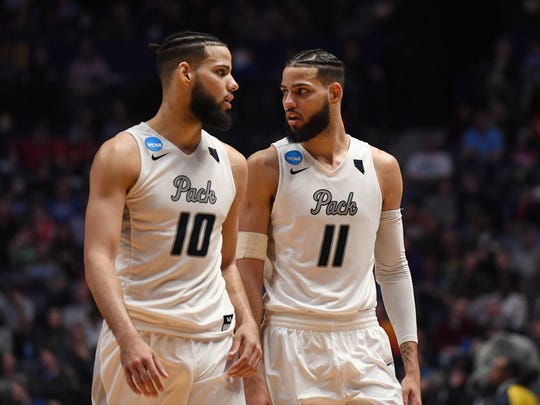 Nevada Wolf Pack forward Caleb Martin (10) and forward Cody Martin (11) talk during the second half against the Texas Longhorns
