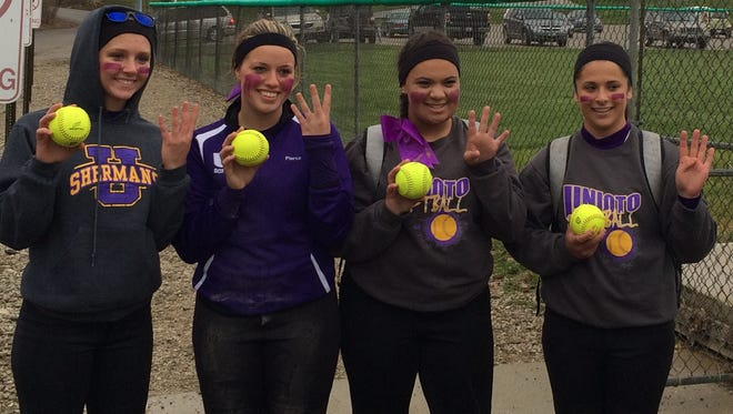 From left to right, Unioto's Summer Sigman, Jordyn Pierce, Ashton Junk, and McKenna Jones show off their home run balls at Huntington High School on April 8. As a team, the Shermans have hit 11 long balls, prompting a new club named the 'Dinger Club'.