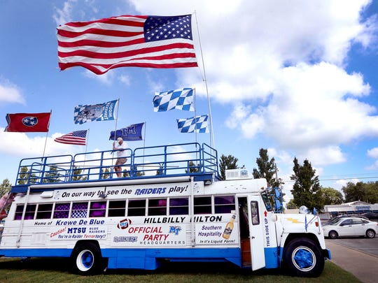 Danny Farrer, the owner of the Hillbilly Hilton raises the MTSU football flag on top of the bus as on Thursday, Sept. 1, 2016., as he prepares for tailgating before the MTSU vs. Alabama A&M game Saturday.