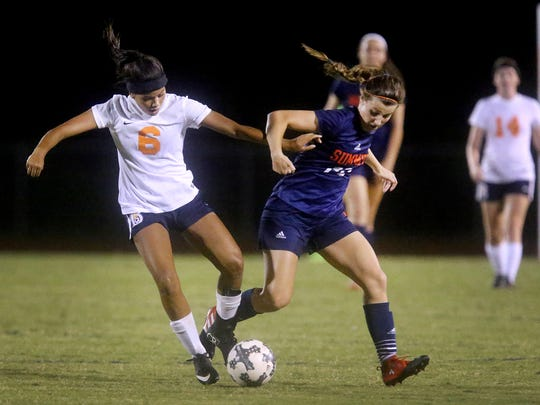 Blackman's Aliyah Vaughn(6) and Summit's Gwyn Cardinal (20) battle for control of the ball during a match at Blackman, on Thursday, Aug. 24, 2017, at Blackman.