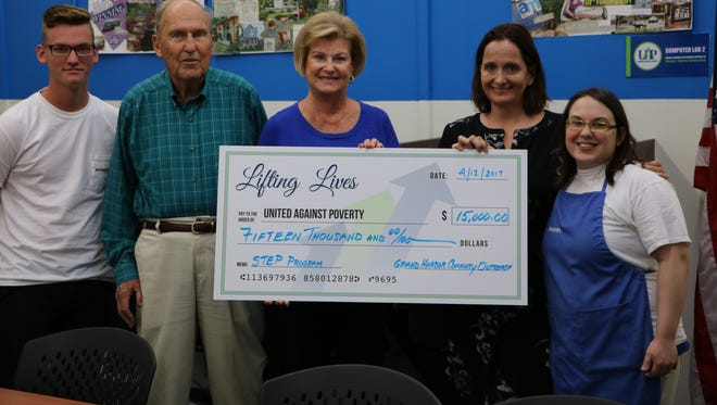 Jack Wittpenn (second from left) and Kathy Tonkel (center), representing Grand Harbor Community Outreach, present a $15,000 grant award to Annabel Robertson (second from right) to fund the Success Training for Employment Program. Also pictured are STEP participants Stephen Fells (left) and Alexandra Norman.