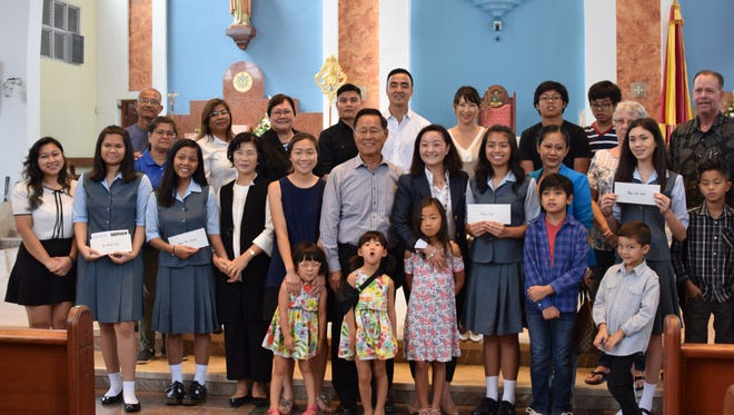Four students from the Academy of Our Lady of Guam received scholarships from the Jane Wha-Young Kim Foundation. Members of the Jane Kim family presented the award to the students after a first day of school Mass held at the Dulce Nombre de Maria Cathedral-Basilica on Aug. 7, 2017.
