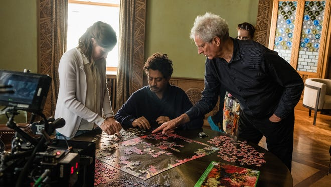"Kelly Macdonald, from left, Irrfan Khan and director Marc Turtletaub on the set of ""Puzzle."""