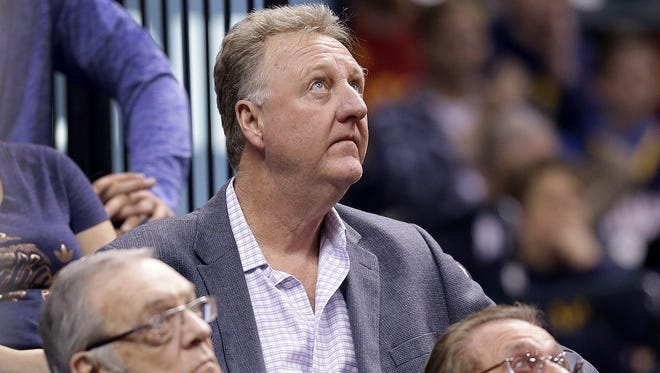 Indiana Pacers president Larry Bird watches the game behind team owner Her Simon,right, and front office advisor Donnie Walsh,left, in the first half of their game Tuesday, April 4, 2016, evening at Bankers Life Fieldhouse.