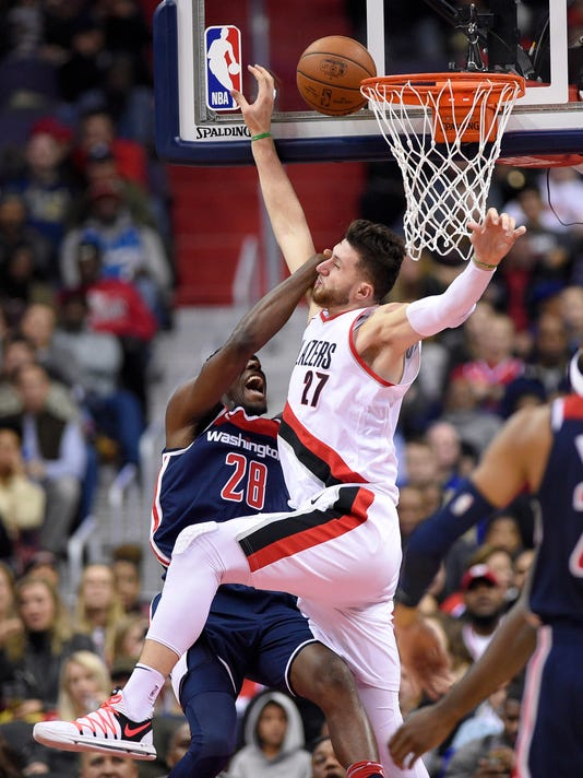Washington Wizards center Ian Mahinmi (28), of France, is blocked at the basket by Portland Trail Blazers center Jusuf Nurkic (27), of Bosnia and Herzegovina, during the second half of an NBA basketball game, Saturday, Nov. 25, 2017, in Washington. The Trail Blazers won 108-105. (AP Photo/Nick Wass)