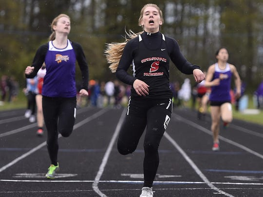 Olivia Wagner of Sevastopol crosses the line to win the 400-meter dash in the Packerland Conference track meet Monday at Southern Door. Wagner also won the 100 and 200 dashes.