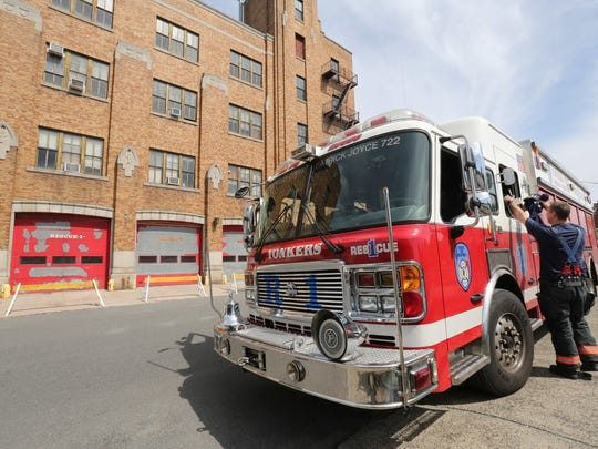 Members of Rescue One put gear away in front of the Yonkers Fire Headquarters, Station One on School Street on Saturday . The building has been condemned.