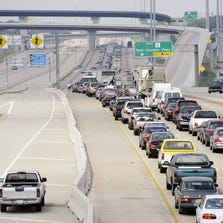 Traffic crawls along highway 59 northbound as residents try to flee in front of Hurricane Rita September 22, 2005 in Houston, Texas. Traffic was backed up for miles leaving the city for two days causing many vehicles to break down and run out of gas.  (