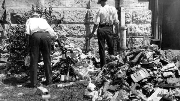 Policemen destroy confiscated liquor in Miami (1925).