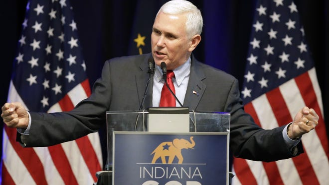 Indiana Gov. Mike Pence speaks during the Indiana Republican Party Spring Dinner April 21 in Indianapolis.