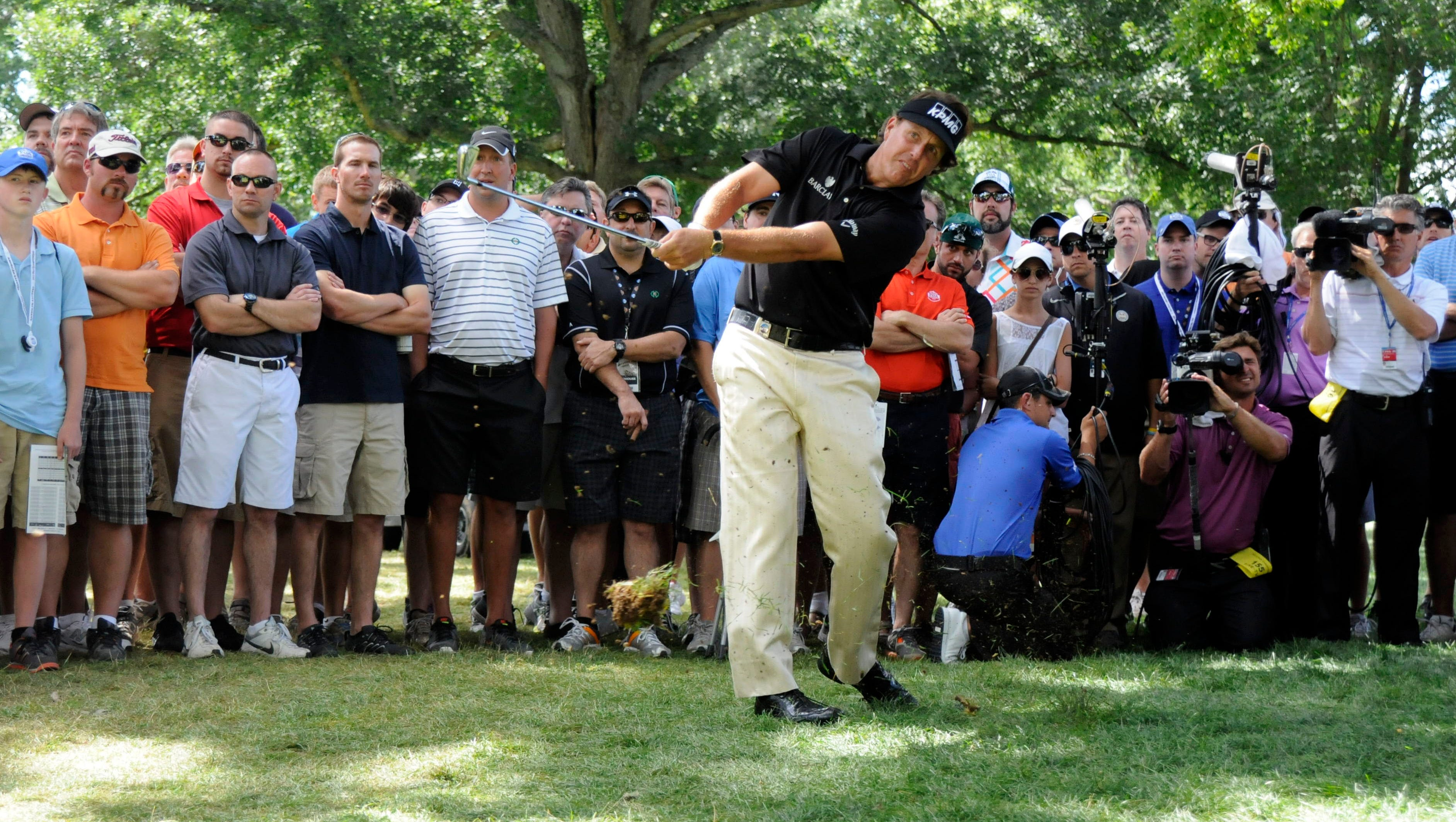 Phil Mickelson plays from the rough at No. 7, on his way to a triple bogey 7.