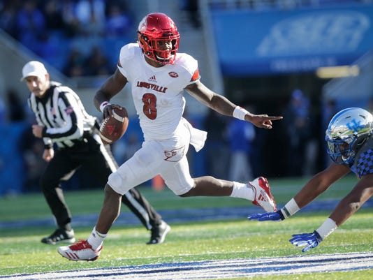 Louisville quarterback Lamar Jackson scrambles past Kentucky defensive tackle Kordell Looney during the second half of an NCAA college football game, Saturday, Nov. 25, 2017, in Lexington, Ky. Louisville won the game 44-17. (AP Photo/David Stephenson)