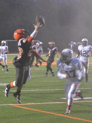 Anderson senior AJ Penley (22) tries to extend for the ball during Friday's win against Turpin.