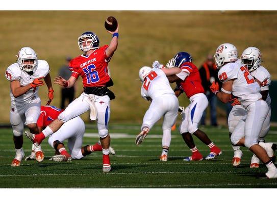 Cooper quarterback Ender Freeman (16) throws a pass