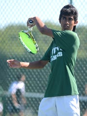 Novi's Sid Amarnath uses his left-hand forehand in a three-set win over Northville's Arvind Kalyana.