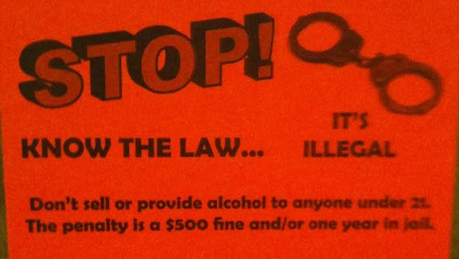 This sticker is meant to serve as a reminder that it's illegal to buy alcohol for anyone under 21.