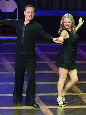 Barry Johnson and Lori Scott dance during the 2016 Dancing for the Space Coast fundraiser.