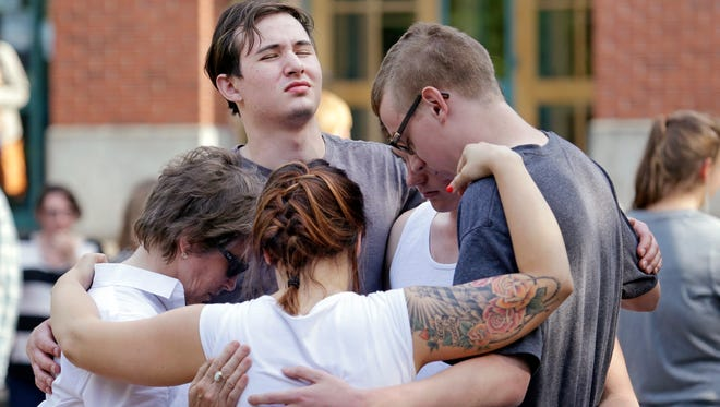 Students and faculty pray together following a shooting on the campus of Seattle Pacific University Thursday.