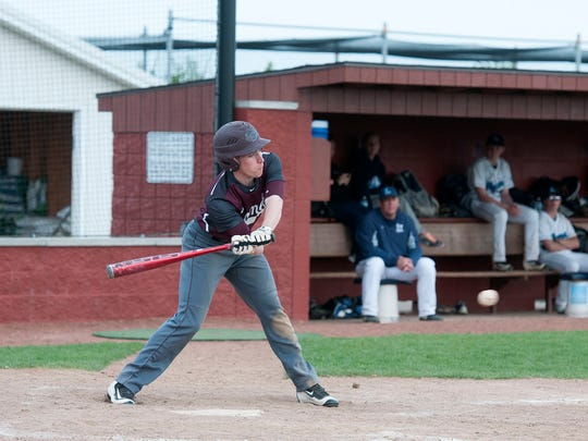 Genoa's Kurtis Lee swings at a low ball during the Comets game at Lake High School in Millbury on Monday May 16, 2016.