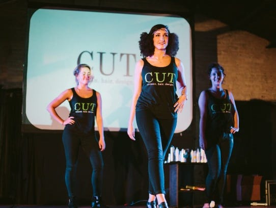 Models hit the cat walk to showcase some amazing hair