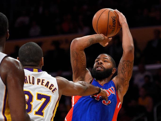 Detroit Pistons forward Marcus Morris, right, shoots