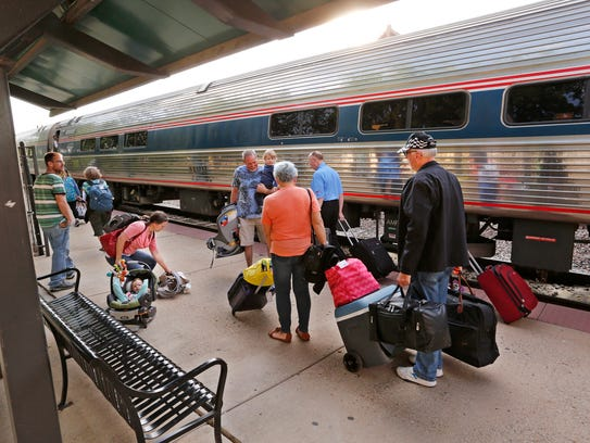 Passengers prepare to board the Cardinal at the Amtrak