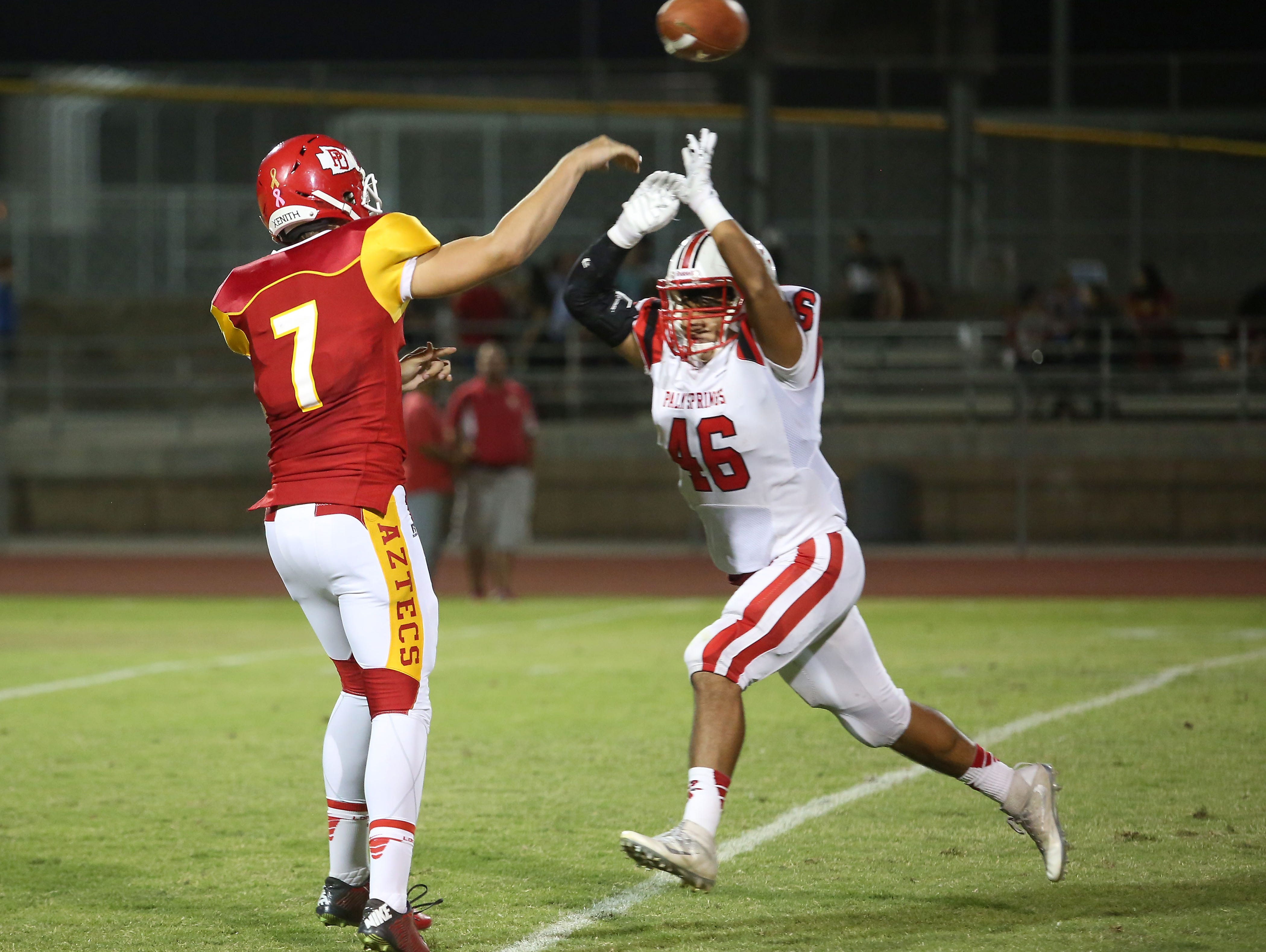 Brian Morales of Palm Springs rushes Palm Desert quarterback Carter Stokes, Oct. 14, 2016.