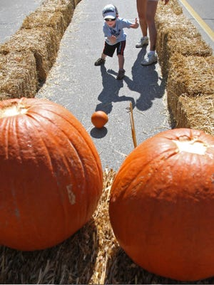 Wyatt Goggins, 4, tries Pumpkin Bowling during Hay Days on Broad Steert in the village of Greendale two years ago.   C.T. Kruger
