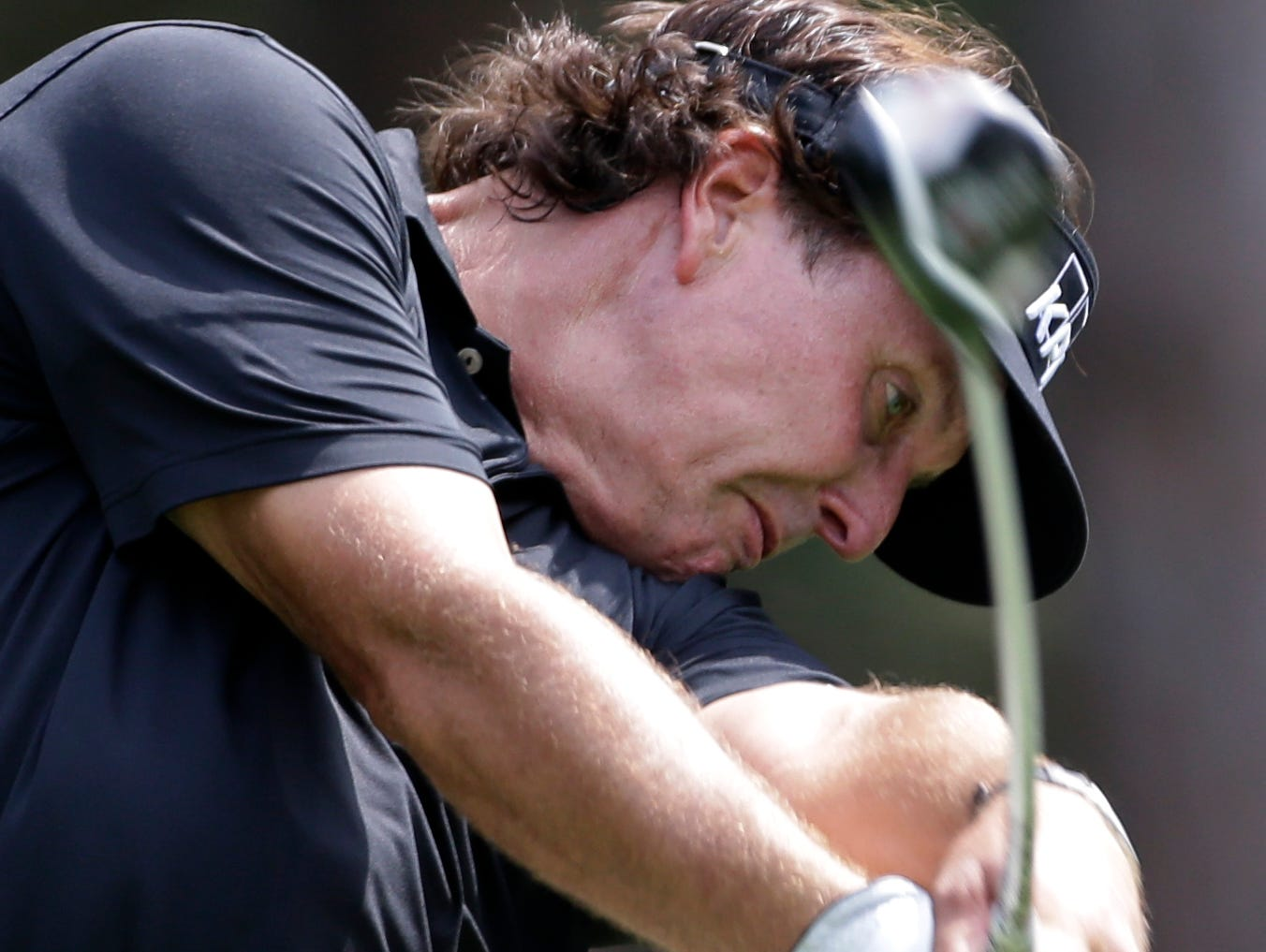 Phil Mickelson tees off on the fourth hole.