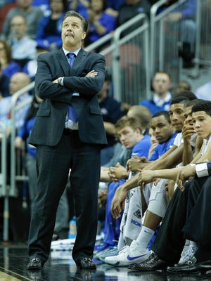 Kentucky head coach John Calipari was not too happy with his team's play at the start of the first half against Hampton  at the NCAA Louisville Regional. By Scott Utterback, The Courier-Journal March 19, 2015