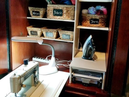 Creating a sewing station from an old entertainment center was the creative idea of Roxy  Birkmaier,   who ended up with a well organized  place for her sewing machine and supplies, and even an ironing board.