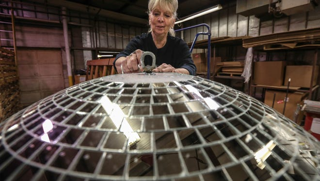 Yolanda Baker, who has been with Omega National Products for 48 years, glues strips of mirrors on a four-foot mirror ball.  In disco's heyday Yolanda and her co-workers would make hundreds of thousands of mirror balls per year.  Now, 40 years after the premier of Saturday Night Fever, Yolanda is the last person in the U.S. still making the reflecting spheres and ships about six per week from the Louisville plant.November 15, 2016