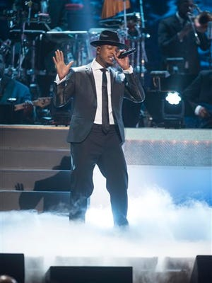 Ne-Yo performs at the BET Honors 2015 at Warner Theater on Saturday, Jan. 24, 2015in Washington. (Photo by Kevin Wolf/Invision/AP)