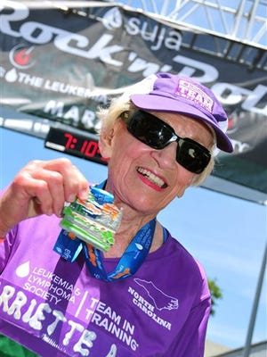 In this June 1, 2014 photo, Harriette Thompson, then 91, is seen at the finish line of the 2014 Suja Rock 'n' Roll Marathon in San Diego. Thompson is scheduled to compete in the 2015 edition in San Diego on Sunday, May 31, 2015. If she completes the race she would become, at age 92, the oldest woman to ever complete a marathon.
