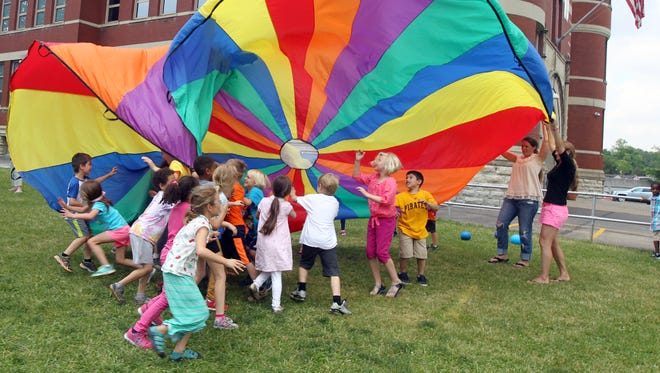 "Hyde Park School first-graders play with a multi-colored ""parachute."" Hyde Park houses one of what is soon-to-be three CPS gifted academies."