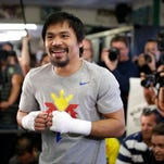 Manny Pacquiao, of the Philippines, smiles during a workout April 15, 2015, in Los Angeles.