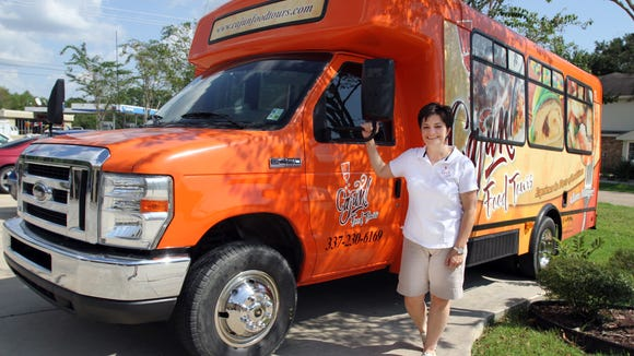 Marie Ducote's Cajun Food Tours bus takes people on tours of local restaurants.