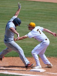 Central first baseman Evan Kahre (7) gets the tag on