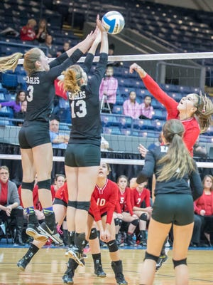 PCA players Grace Kellogg (No. 3) and Melissa Paige Perkey (No. 13) go up for the block Thursday against a Battle Creek St. Philip player.
