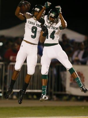 Detroit Cass Tech's Donovan Peoples-Jones, left, celebrates with teammate Donovan Parker after Peoples-Jones scored a  touchdown on Aug. 29, 2014.