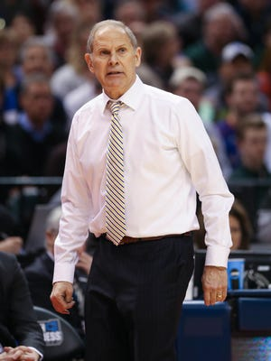 Michigan Wolverines head coach John Beilein on the bench during the second half of U-M's 73-69 win over Louisville on Sunday, March 19 at Bankers Life Fieldhouse in Indianapolis in the second round of the 2017 NCAA tournament.