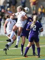 Arlington's Molly Feighan (29) works for a header on