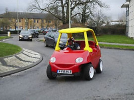 A grown-up version of a children s push car is up for auction on eBay.