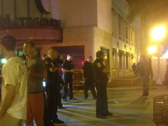 Police officers are stationed at Hendry and Second streets after responding to a shooting Saturday night at Zombicon in downtown Fort Myers.