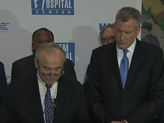New York Police Commissioner William Bratton and New York City Mayor Bill de Blasio speak at a Wednesday press conference about the shooting and death of Officer Randolph Holder.