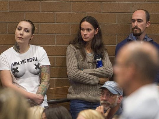 Samantha Six, left, waits to speak with the Fort Collins City Council during the public comment period on giving women the permission to appear topless in public Tuesday. Council members voted to not allow the act.