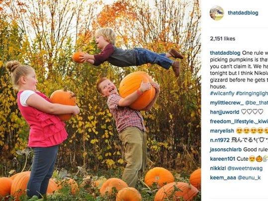 The family picks pumpkins.